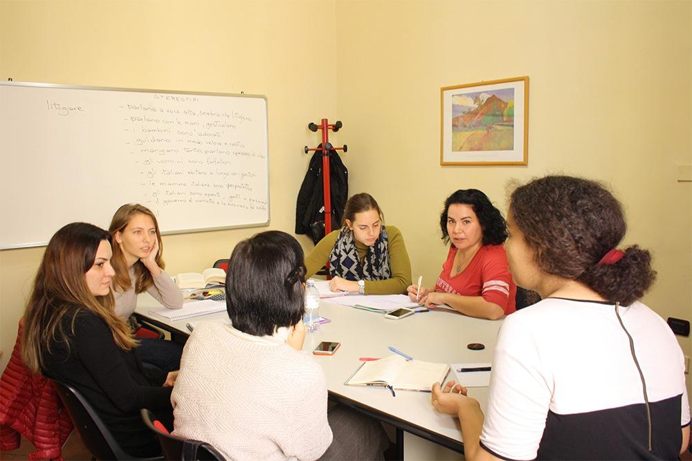 Students talking in Italian in a class