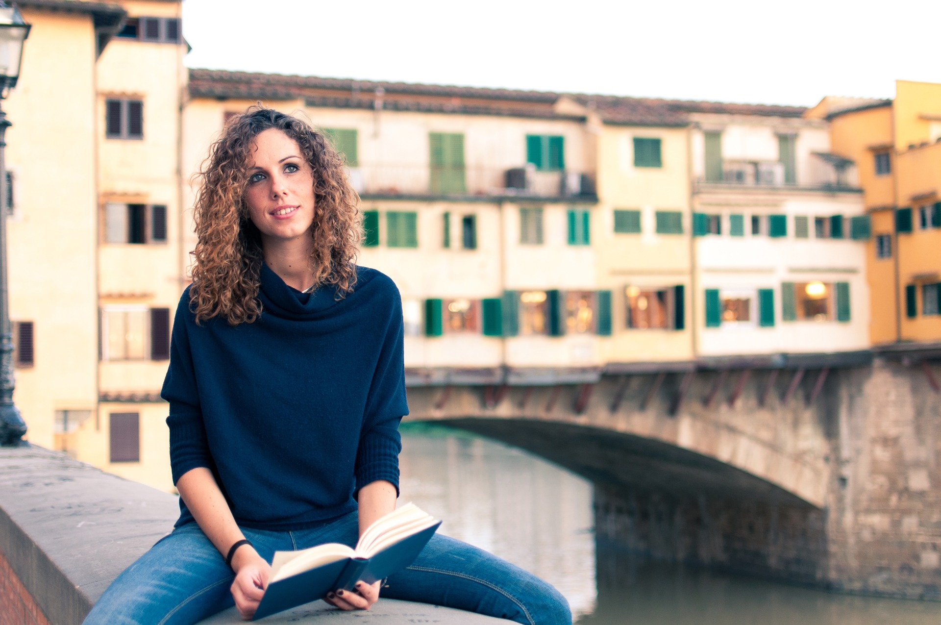 A student with a book near Ponte Vecchio in Florence