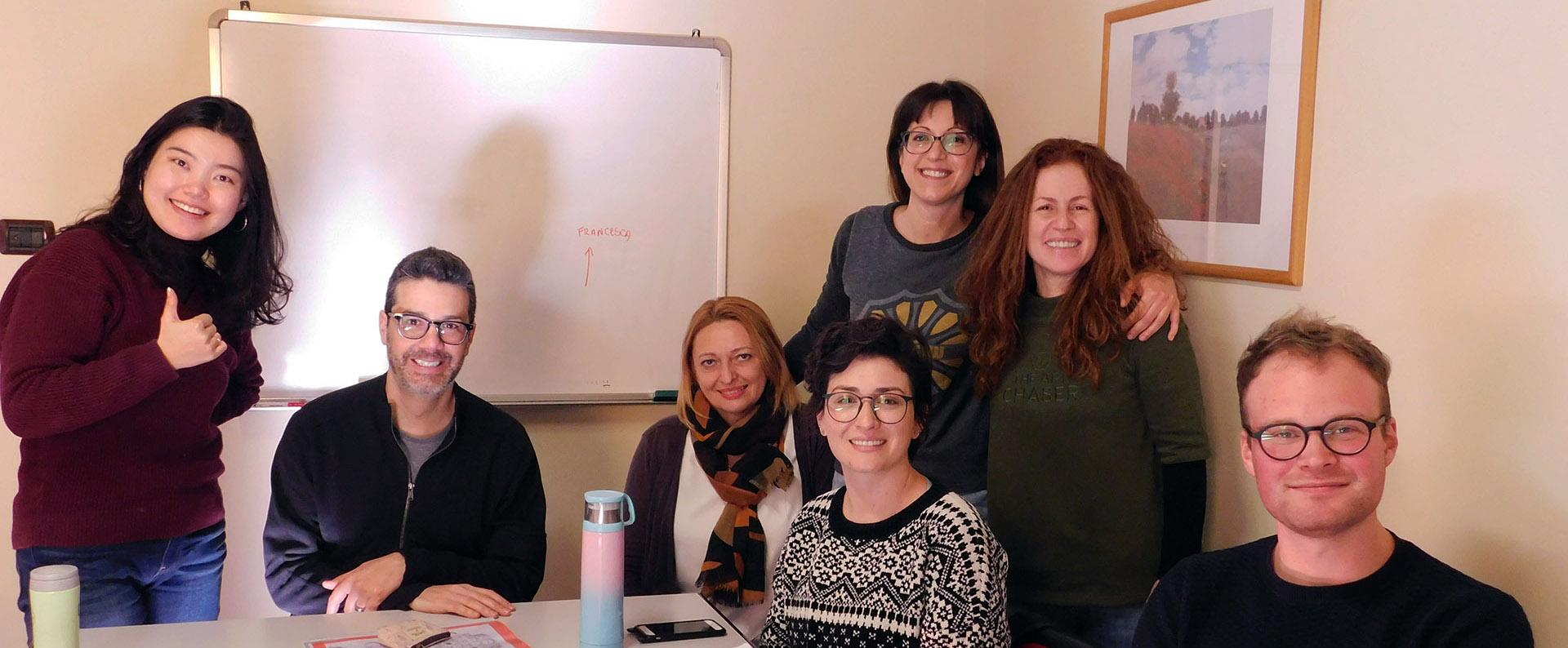 Parola's Italian language students in a class break