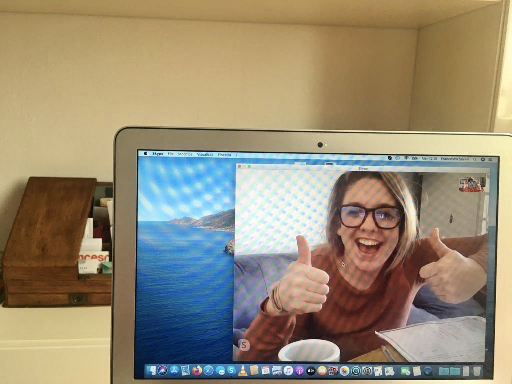 Happy student in an online Italian language lesson